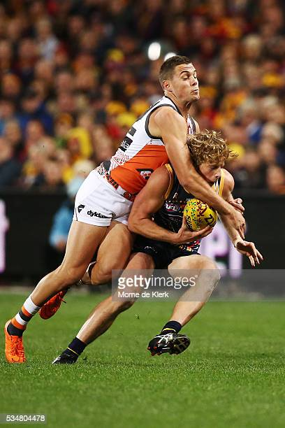 Josh Kelly of the Giants tackles Rory Sloane of the Crows during the round 10 AFL match between the Adelaide Crows and the Greater Western Sydney...