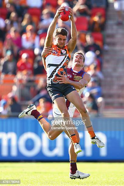 Josh Kelly of the Giants takes a mark during the round 10 AFL match between the Greater Western Sydney Giants and the Brisbane Lions at Spotless...