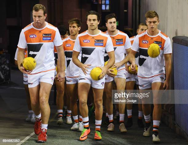 Josh Kelly of the Giants walks out for warm up during the round 12 AFL match between the Carlton Blues and the Greater Western Sydney Giants at...