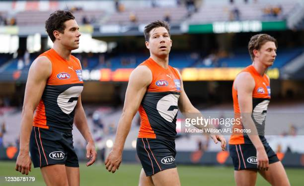Josh Kelly, Toby Greene and Lachie Whitfield of the Giants look dejected after a loss during the 2021 AFL Round 15 match between the GWS Giants and...