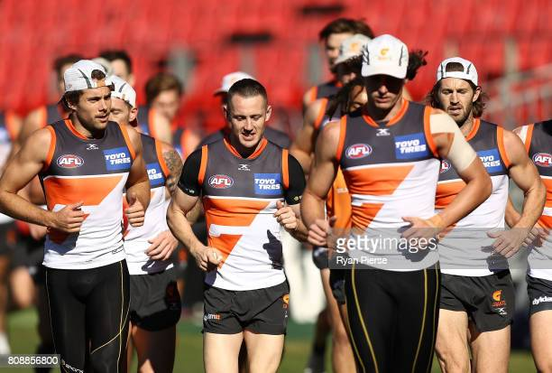 Josh Kelly Tom Scully and Callan Ward of the Giants train during a Greater Western Sydney Giants AFL training session at Spotless Stadium on July 5...
