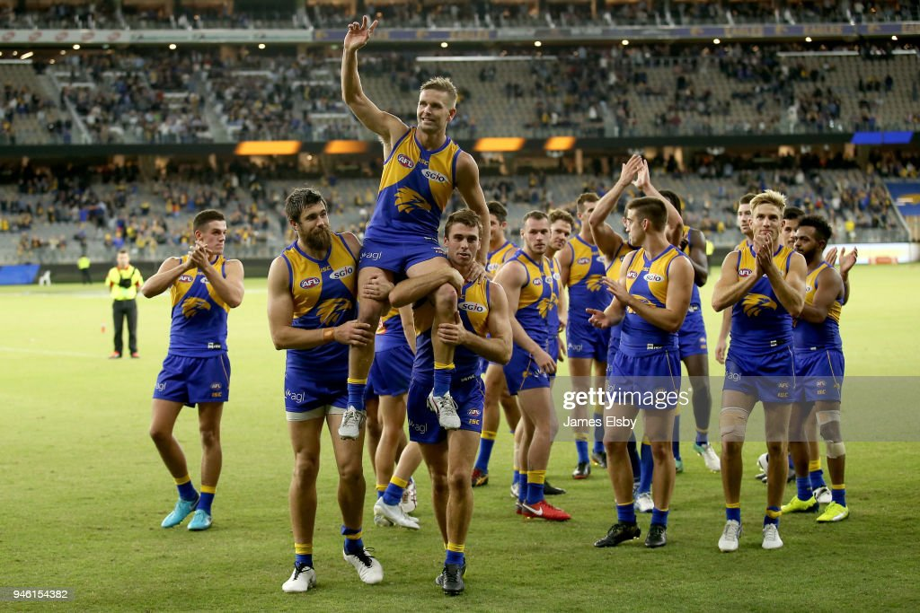 Josh Kennedy and Jamie Cripps chair off Mark LeCras of the Eagles after his 200th game during the round four AFL match between the West Coast Eagles and the Gold Coast Suns at Optus Stadium on April 14, 2018 in Perth, Australia.
