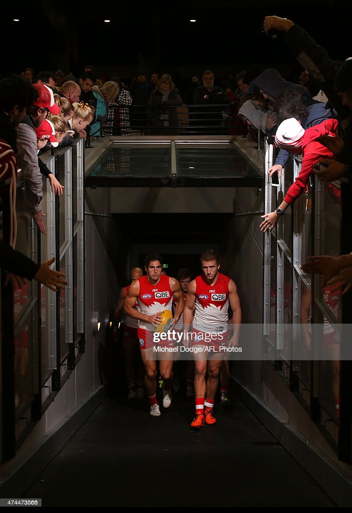 Josh Kennedy and Kieran Jack (R) of the Swans walk out after half time during the round eight AFL match between the Hawthorn Hawks and the Sydney Swans at Melbourne Cricket Ground on May 23, 2015 in Melbourne, Australia.
