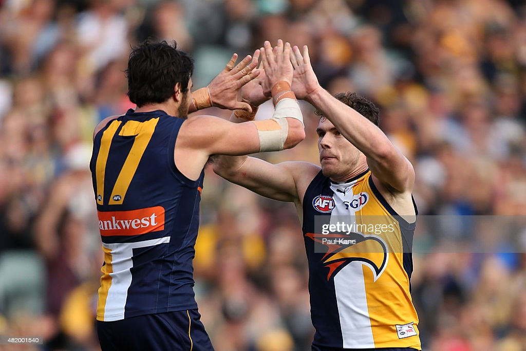 Josh Kennedy and Luke Shuey of the Eagles celebrate a goal during the round 17 AFL match between the West Coast Eagles and the Sydney Swans at Domain Stadium on July 26, 2015 in Perth, Australia.