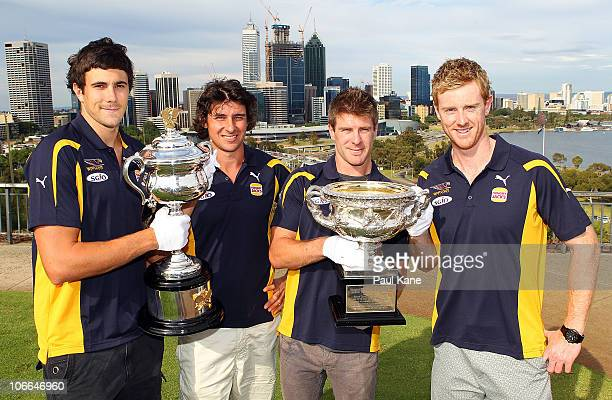 Josh Kennedy Andrew Embley Beau Waters and Ashley Hansen of the West Coast Eagles pose with the Australian Open Trophies during the Australian Open...