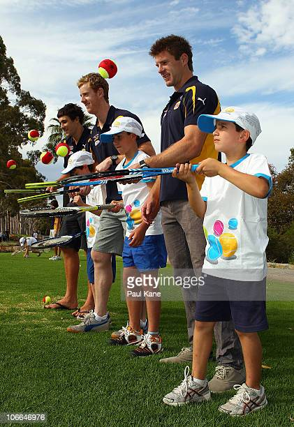 Josh Kennedy Ashley Hansen and Beau Waters of the West Coast Eagles pose with junior tennis players during the Australian Open trophy tour at King...