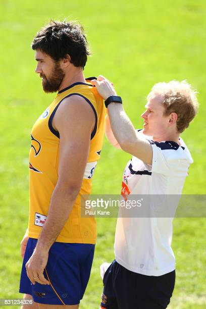 Josh Kennedy gets his GPS unit fitted during a West Coast Eagles AFL training session at Domain Stadium on August 14 2017 in Perth Australia