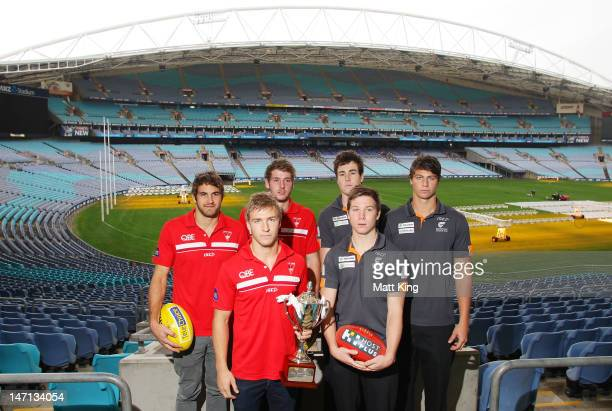 Josh Kennedy, Kieren Jack and Alex Johnson of the Swans and Jeremy Cameron, Toby Greene and Jonathon Patton of the Giants pose during a press...