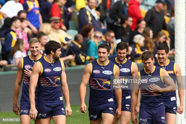 Josh Kennedy looks back to Tom Barrass while walking laps during a West Coast Eagles AFL training session at Domain Stadium on September 11 2017 in...
