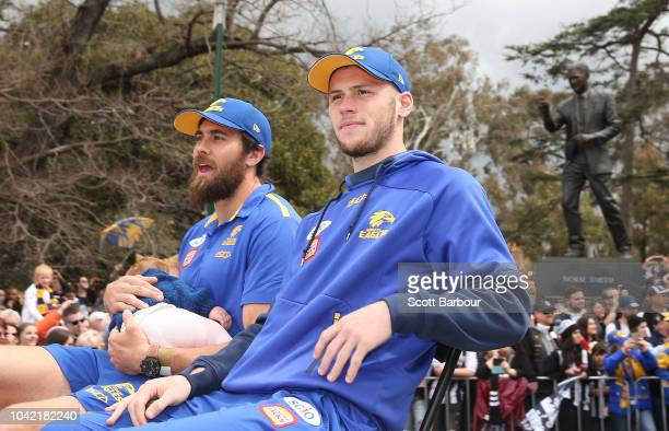Josh Kennedy of the Eagles and Daniel Venables of the Eagles wave to the crowd during the 2018 AFL Grand Final Parade on September 28 2018 in...