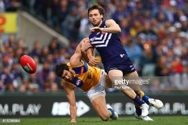 Josh Kennedy of the Eagles and Joel Hamling of the Dockers contest for the ball during the round 17 AFL match between the Fremantle Dockers and the...