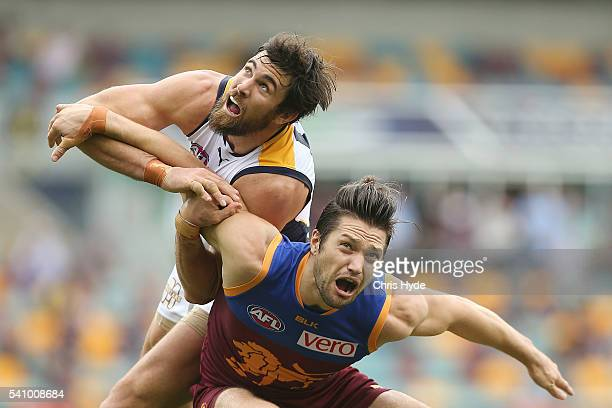 Josh Kennedy of the Eagles and Stefan Martin of the Lions compete for the ball during the round 13 AFL match between the Brisbane Lions and the West...