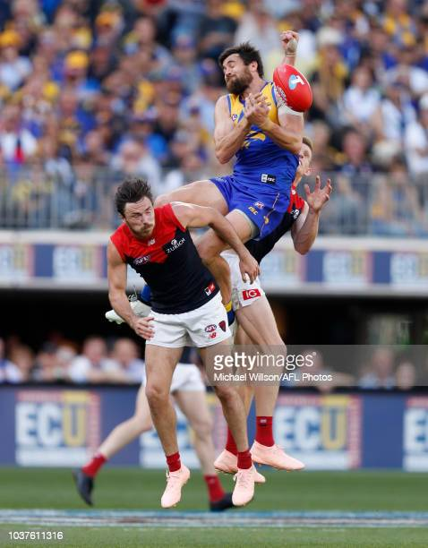 Josh Kennedy of the Eagles attempts a spectacular mark over Michael Hibberd of the Demons and Sam Frost of the Demons during the 2018 AFL Second...