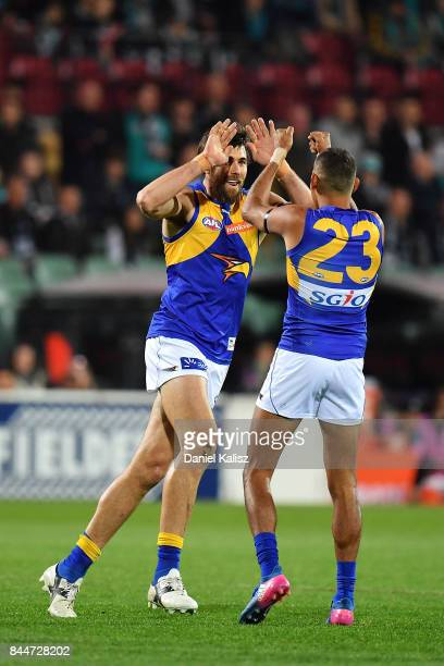 Josh Kennedy of the Eagles celebrates with Lewis Jetta of the Eagles after kicking a goal during the AFL First Elimination Final match between Port...