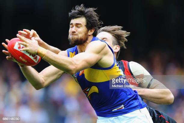 Josh Kennedy of the Eagles competes for the ball against Michael Hartley of the Bombers during the round nine AFL match between the Essendon Bombers...