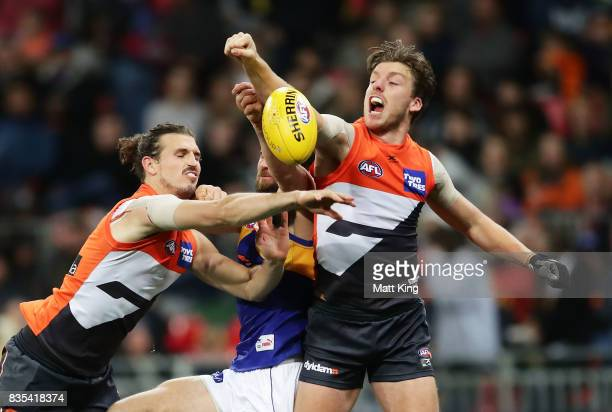 Josh Kennedy of the Eagles competes for the ball against Phil Davis and Aidan Corr of the Giants during the round 22 AFL match between the Greater...