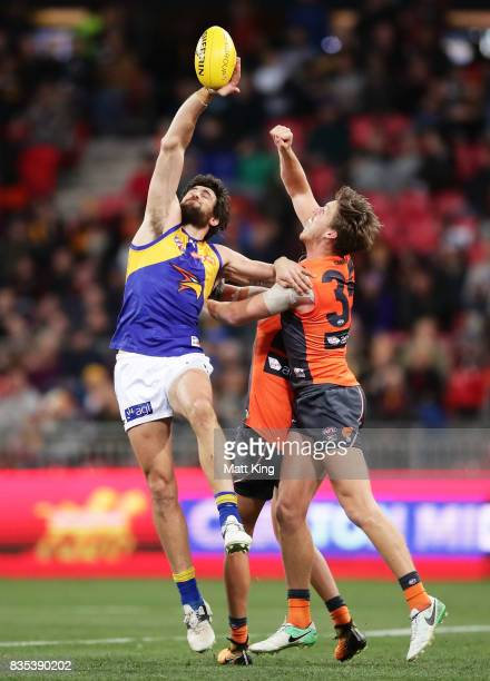Josh Kennedy of the Eagles is challenged by Aidan Corr of the Giants during the round 22 AFL match between the Greater Western Sydney Giants and the...
