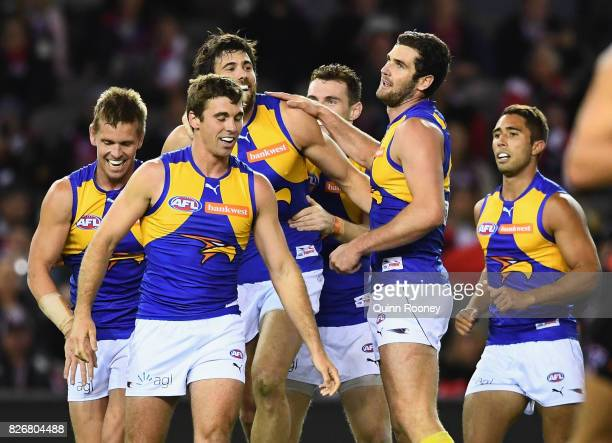 Josh Kennedy of the Eagles is congratulated by team mates after kicking a goal during the round 20 AFL match between the St Kilda Saints and the West...