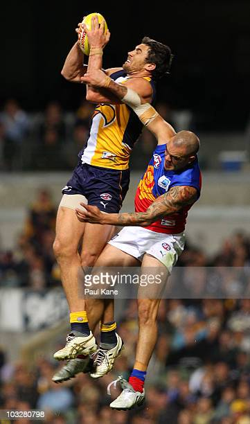 Josh Kennedy of the Eagles marks in front of Ashley McGrath of the Lions during the round 19 AFL match between the West Coast Eagles and the Brisbane...