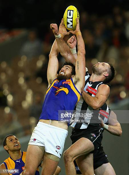 Josh Kennedy of the Eagles marks infront of Nathan Brown of the Magpies during the round 22 AFL match between the Collingwood Magpies and the West...