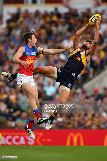 Josh Kennedy of the Eagles marks the ball against Daniel McStay of the Lions during the AFL round one match between the West Coast Eagles and the...