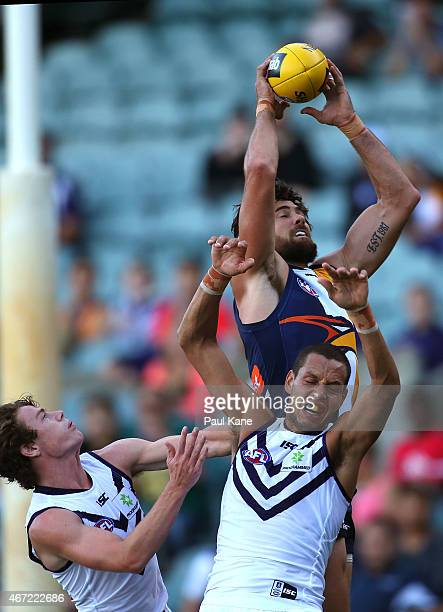Josh Kennedy of the Eagles marks the ball against Michael Johnson of the Dockers during the NAB Challenge AFL match between the West Coast Eagles and...