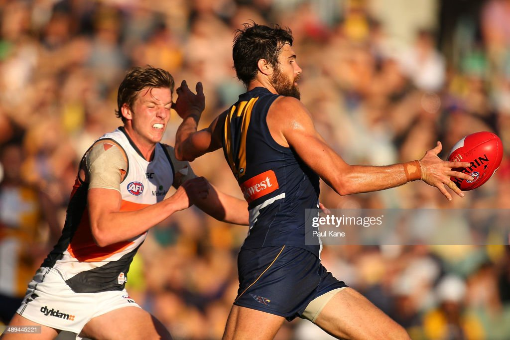 Josh Kennedy of the Eagles snaps on goal against Adam Kennedy of the Giants during the round eight AFL match between the West Coast Eagles and the Greater Western Sydney Giants at Patersons Stadium on May 11, 2014 in Perth, Australia.