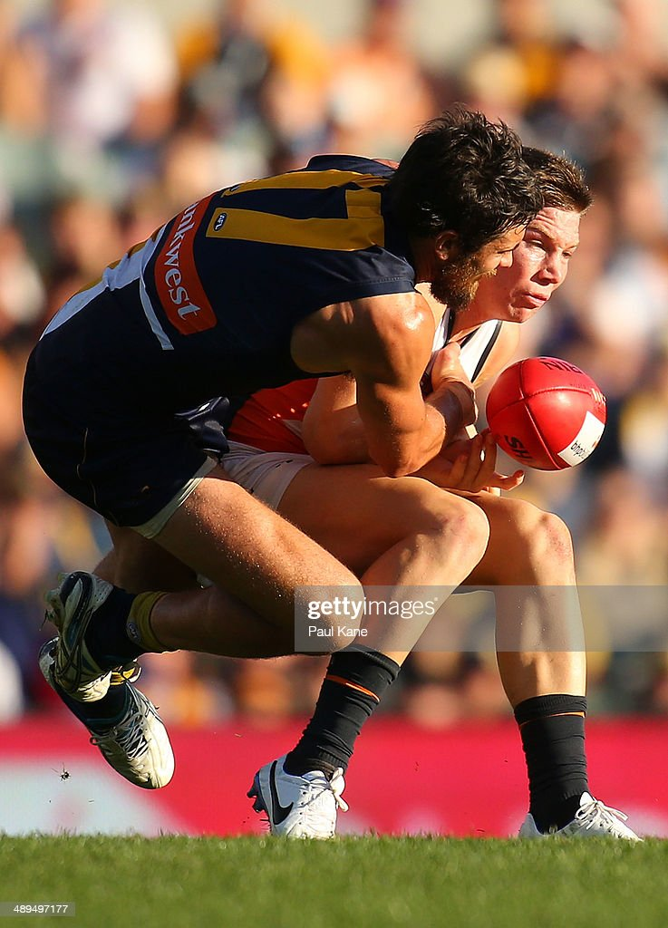 Josh Kennedy of the Eagles tackles Toby Greene of the Giants during the round eight AFL match between the West Coast Eagles and the Greater Western Sydney Giants at Patersons Stadium on May 11, 2014 in Perth, Australia.