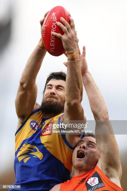 Josh Kennedy of the Eagles takes a mark over Heath Shaw of the Giants during the round eight AFL match between the Greater Western Giants and the...