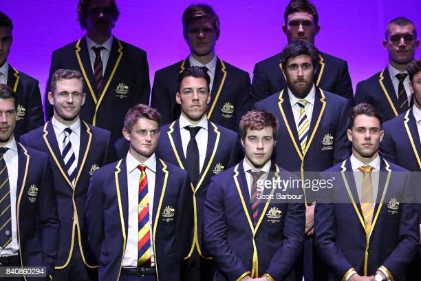 Josh Kennedy of the Eagles Zach Merrett of the Bombers Joel Selwood of the Cats Dylan Shiel of the Giants and the AFL All Australian team pose on...