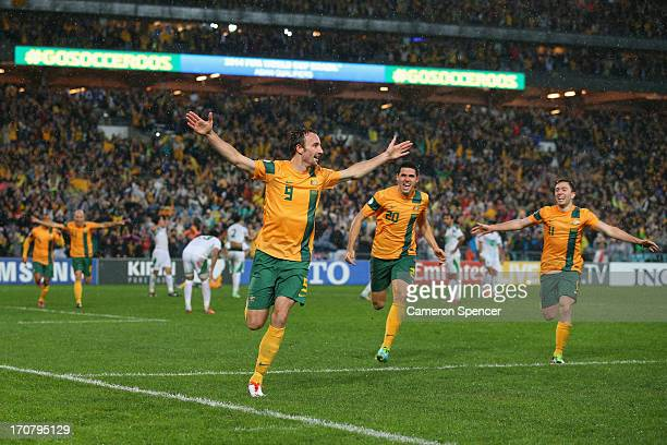 Josh Kennedy of the Socceroos celebrates heading the ball to score a goal during the FIFA 2014 World Cup Asian Qualifier match between the Australian...