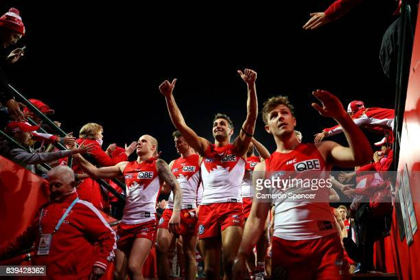 Josh Kennedy of the Swans and team mates thank fans after winning the round 23 AFL match between the Sydney Swans and the Carlton Blues at Sydney...