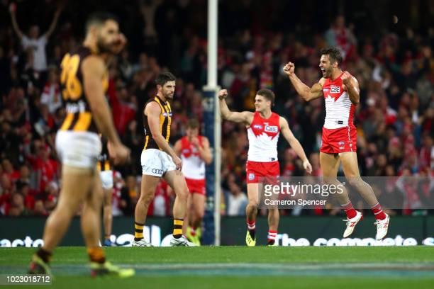 Josh Kennedy of the Swans celebrates kicking a goal with team mates during the round 23 AFL match between the Sydney Swans and the Hawthorn Hawks at...
