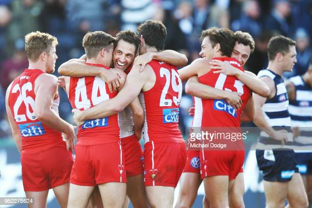 Josh Kennedy of the Swans celebrates the win on the final siren with teammates during the round six AFL match between the Geelong Cats and Sydney...