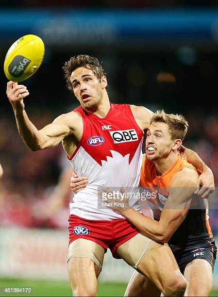 Josh Kennedy of the Swans competes for the ball against Devon Smith of the Giants during the round 15 AFL match between the Sydney Swans and the...