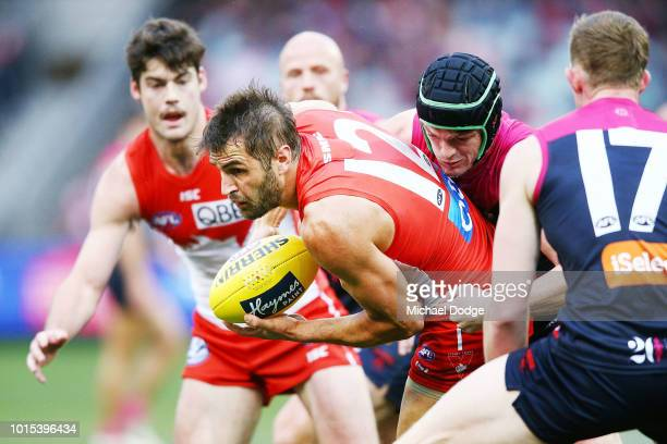 Josh Kennedy of the Swans is tackled by Angus Brayshaw of the Demons during the round 21 AFL match between the Melbourne Demons and the Sydney Swans...