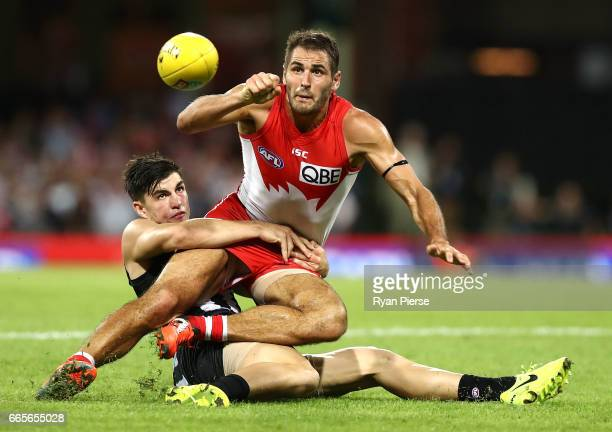 Josh Kennedy of the Swans is tackled by Brayden Maynard of the Magpies during the round three AFL match between the Sydney Swans and the Collingwood...