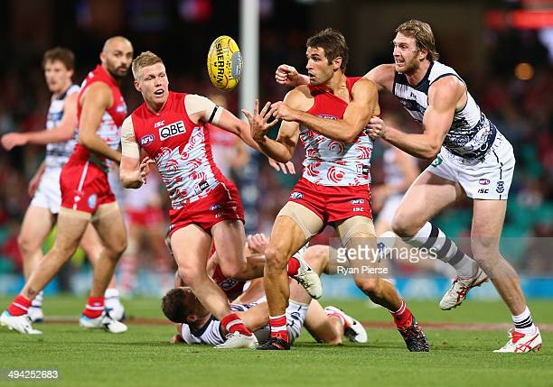 Josh Kennedy of the Swans is tackled by Dawson Simpson of the Cats during the round 11 AFL match between the Sydney Swans and the Geelong Cats at the...