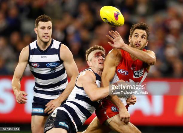 Josh Kennedy of the Swans is tackled by Scott Selwood of the Cats during the 2017 AFL Second Semi Final match between the Geelong Cats and the Sydney...