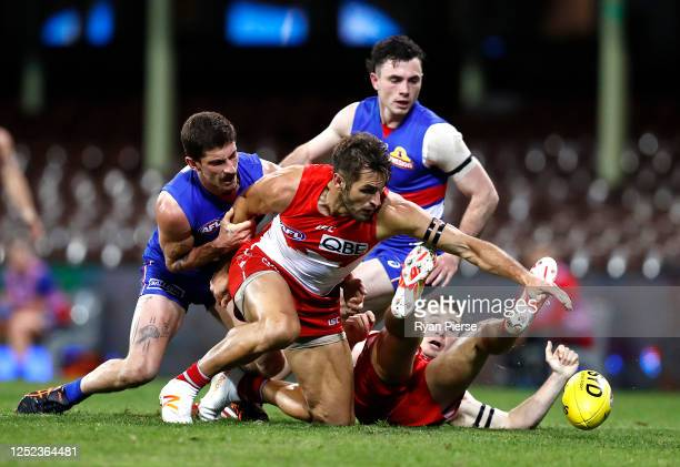 Josh Kennedy of the Swans is tackled by Tom Liberatore of the Bulldogs during the round 4 AFL match between the Sydney Swans and the Western Bulldogs...