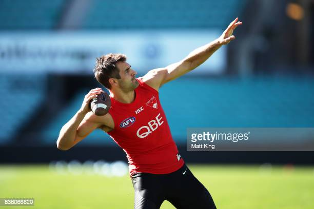 Josh Kennedy of the Swans throws an American football in warm up during a Sydney Swans AFL training session at Sydney Cricket Ground on August 24...
