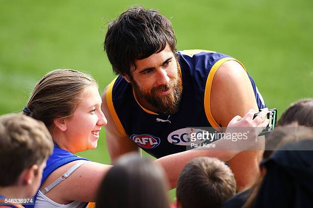 Josh Kennedy poses for a photo with a supporter during a West Coast Eagles AFL training session at Domain Stadium on July 12 2016 in Perth Australia