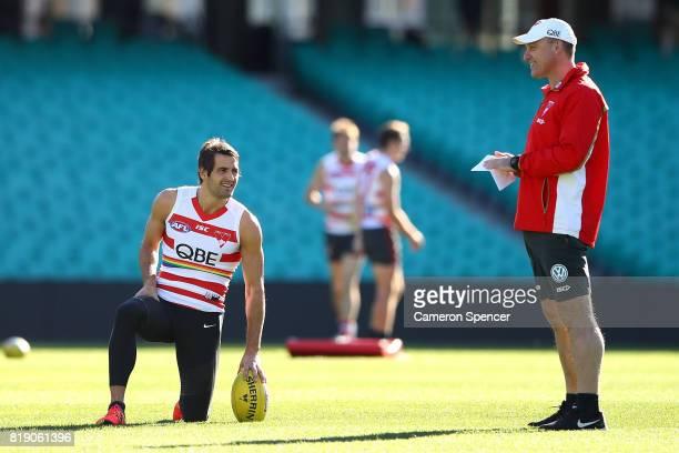 Josh Kennedy talks with coach John Longmire during a Sydney Swans AFL training session at Sydney Cricket Ground on July 20 2017 in Sydney Australia