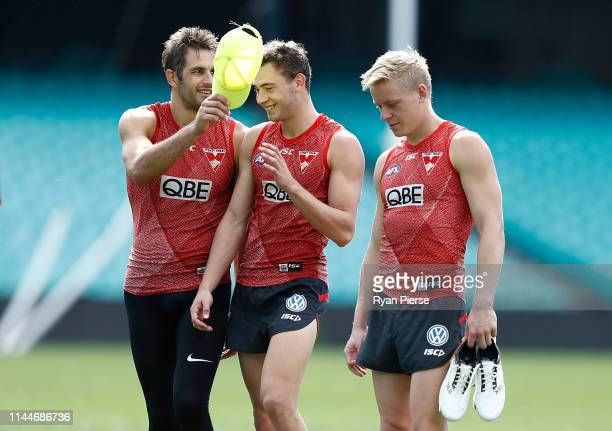 Josh Kennedy Will Hayward and Isaac Heeney of the Swans walk from the ground during a Sydney Swans AFL training session at the Sydney Cricket Ground...