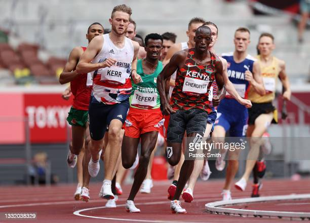 Josh Kerr of Team Great Britain and Timothy Cheruiyot of Team Kenya compete in round one of the Men's 1500m heats on day eleven of the Tokyo 2020...