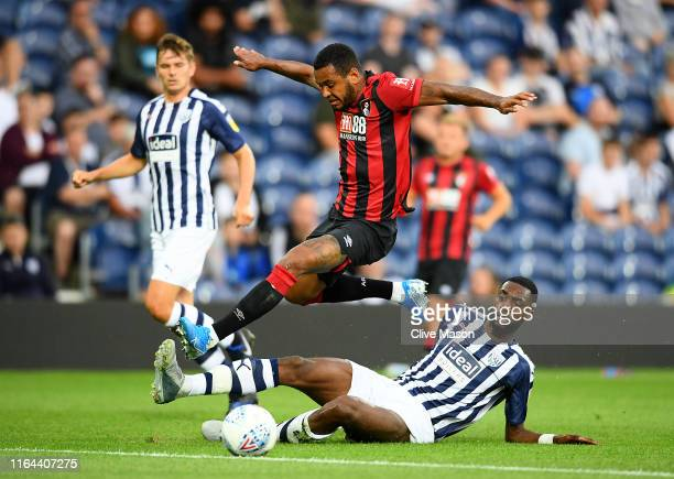Josh King of Bournemouth is challenged by Semi Ajayi of West Bromwich Albion during the PreSeason Friendly match between West Bromwich Albion and...