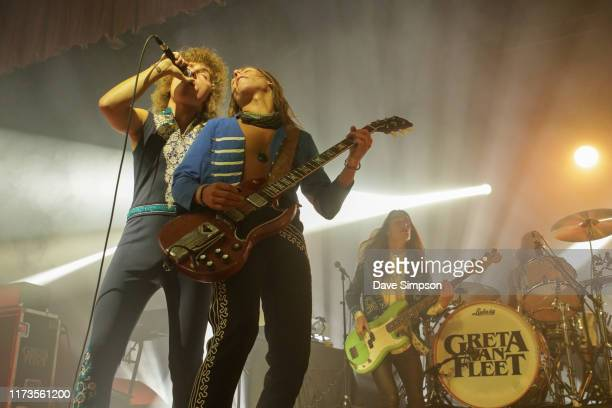 Josh Kiszka and Jake Kiszka of Greta Van Fleet perform on stage at Logan Campbell Centre on September 10, 2019 in Auckland, New Zealand.