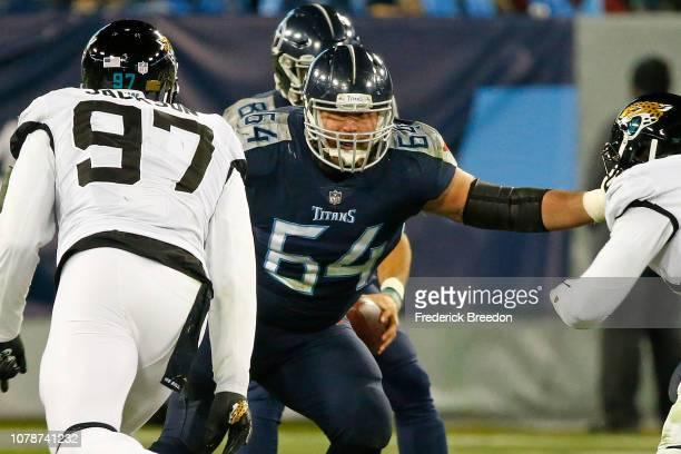 Josh Kline of the Tennessee Titans blocks Malik Jackson of the Jacksonville Jaguars at Nissan Stadium on December 6 2018 in Nashville Tennessee