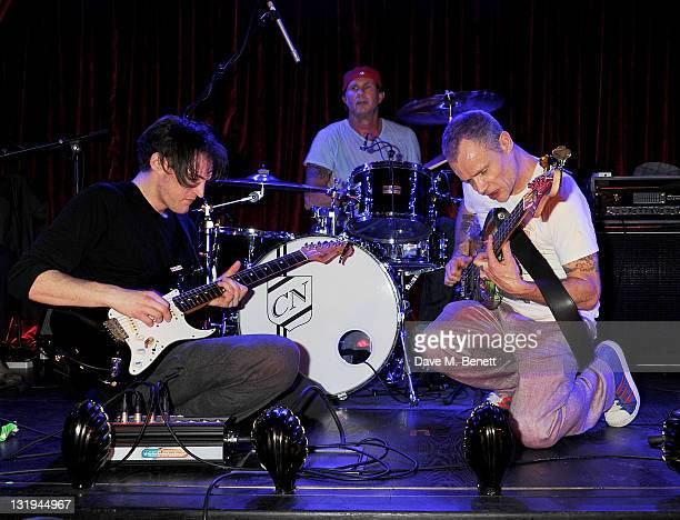 Josh Klinghoffer Chad Smith and Flea of the Red Hot Chili Peppers perform at the launch of Flea and Damien Hirst's new line of Spin Bass Guitar at...