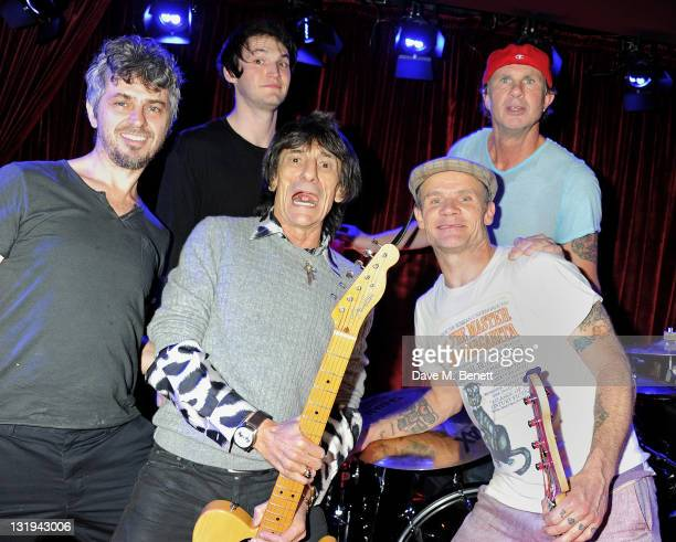 Josh Klinghoffer Ronnie Wood Flea and Chad Smith attend the launch of Flea and Damien Hirst's new line of Spin Bass Guitar at Club Nouveau in...